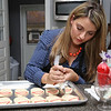 Ken Yuszkus/Staff photo      Aime Pope decorates cookies in her kitchen. She was recently featured in a Christmas cookie baking competition on The Food Network.      11/3/17
