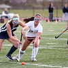 HADLEY GREEN/Staff photo<br /> Gloucester's Marisa Eneg (13) fights for the ball at the Gloucester v. Wilmington Division 2 North quarterfinals field hockey game at Gloucester High School.<br /> <br /> 11/04/17