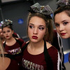 HADLEY GREEN/Staff photo<br /> Gloucester cheerleaders watch their competitors perform before going onstage at the Massachusetts State Cheerleading Tournament at Worcester State University.<br /> <br /> 11/19/17