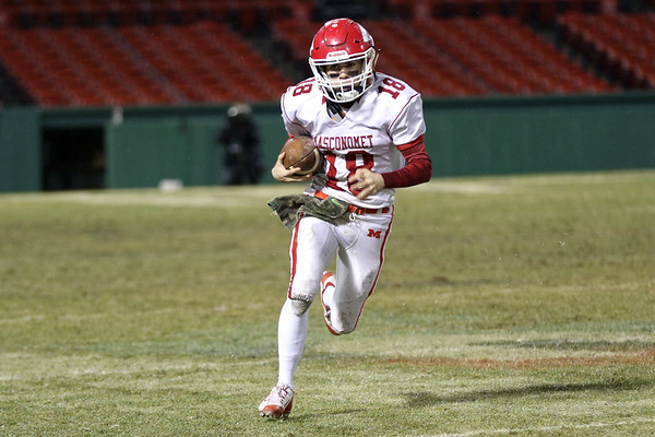 HADLEY GREEN/Staff photo<br /> Masconomet's Marshall Lastes (18) sprints down the field at the Masconomet v. Everett football game at Fenway Park.<br /> <br /> 11/22/17