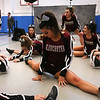 HADLEY GREEN/Staff photo<br /> Gloucester cheerleaders stretch before competing at the Massachusetts State Cheerleading Tournament at Worcester State University.<br /> <br /> 11/19/17
