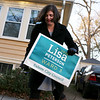 HADLEY GREEN/Staff photo<br /> Newly elected Salem City Councilor Lisa Peterson removes yard signs from her neighborhood after toppling incumbent Steve Lovely in the Ward 3 race. 11/07/17