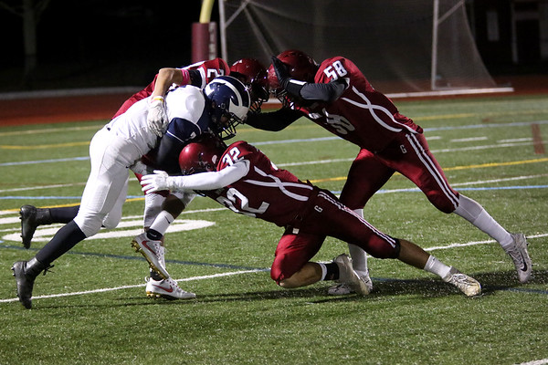 HADLEY GREEN/Staff photo<br /> Gloucester's Brandon Rivera (24), Marc Smith (32) and Carlos Hernandez Reyes (58) tackle Swampscott's Isaiah Bascon (7) at the Gloucester v. Swampscott football game at Gloucester High School.<br /> 11/10/17