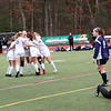 HADLEY GREEN/Staff photo<br /> Danvers players celebrate after Hannah Lejeune (8) scores on Medway goalie Samantha Murray (5) at the Medway v. Danvers Division 2 girls soccer state championship game at Fitchburg State University.<br /> <br /> 11/18/17