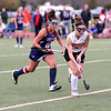 HADLEY GREEN/Staff photo<br /> Beverly's Sabrina Beaudry (8) runs with the ball while Lincoln-Sudbury's Mackenzie Madden (12) plays defense at the Beverly v. Lincoln-Sudbury field hockey playoff game at Beverly High School. 11/02/17