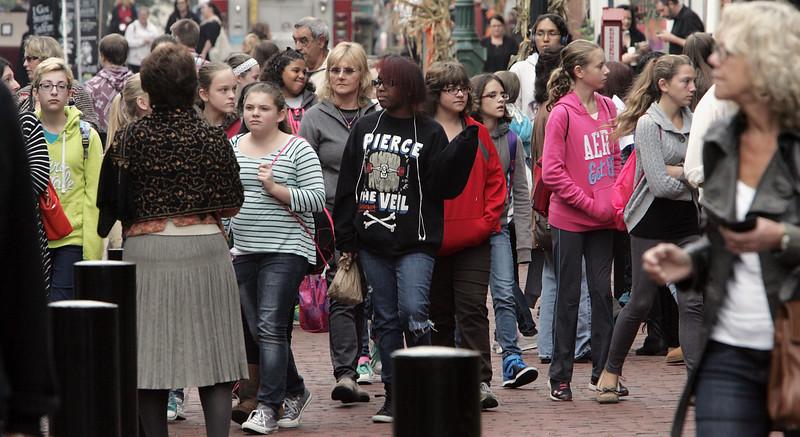 KEN YUSZKUS/Staff photo. Pre-Halloween Crowds at the Essex Street pedestrian mall in Salem on Wednesday. 10/29/14