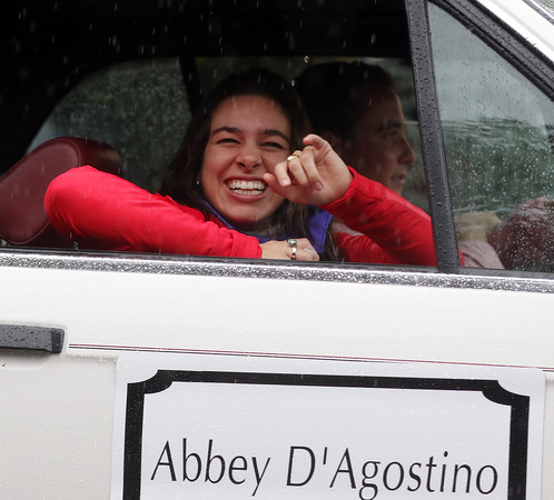 DAVID LE/Staff photo. Topsfield native, former Masco standout, and Olympian Abbey D'Agostino, drew loud applause as she passed down Main Street during the Topsfield Fair Parade on a rainy Saturday morning, where D'Agostino served as the Grand Marshal. 10/1/16.