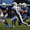 DAVID LE/Staff photo. Peabody senior captain Jake Doherty (11) looks for room while returning an interception against Danvers. 10/21/16