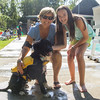 PARKER FISH/ Photo. Sue (left) and Patsy (Right) pose with their three year old Portuguese Water Dog Johnny during the first annual Doggie Dip at the Jewish Community center in Marblehead. 9/17/16