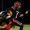 DAVID LE/Staff photo. Salem senior quarterback Jared Lubas turns the corner against Gloucester. 10/14/16.