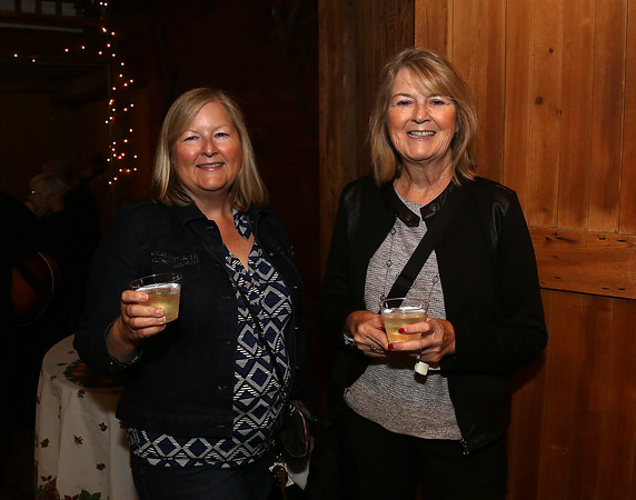 DAVID LE/Staff photo. Sandy Jones and Pat Lanciani at the Starry, Starry Night Fundraiser held at the Smith Barn on Brooksby Farm. 10/6/16.