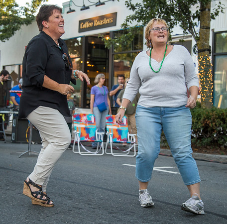 PARKER FISH/ Photo. Liz Tarricone (left) and Anne Barbin ( right) dance to the live entertainment at the Beverly Block Party on Saturday. 9/17/16