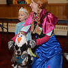"RYAN HUTTON/ Staff photo<br /> Dressed as the character Anna from the Disney film ""Frozen"", Jenny Plassmeier tries to get her dog Marry Poppins to wear an Olaf the Snowman costume properly while her daughter Lexi, 2, is dressed at Elisa at the Peabody Halloween celebration at the Knights of Columbus hall on Thursday."