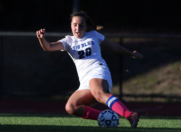 DAVID LE/Staff photo. Swampscott senior Maggie DiGrande (28) tries to make a cross against Beverly. 10/6/16.