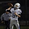 DAVID LE/Staff photo. Danvers senior Dean Borders (16) fires a touchdown pass against Lynn Classical. 9/30/16.
