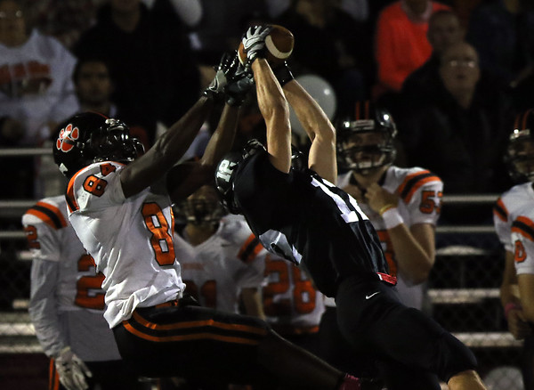 DAVID LE/Staff photo. Marblehead senior cornerback Justin Faia leaps high in the air and picks off a pass from Beverly quarterback Kevin Morency intended for senior Hugh Calice (84). 10/7/16.