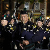 DAVID LE/Staff photo. Peter Gifford, of the Salem Police Department, plays the bagpipes while marching in the annual Haunted Happenings Parade on Thursday. 10/6/16.