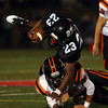 DAVID LE/Staff photo. Marblehead senior running back Jaason Lopez (23) gets upended by Beverly senior captain Sam Abate. 10/7/16.