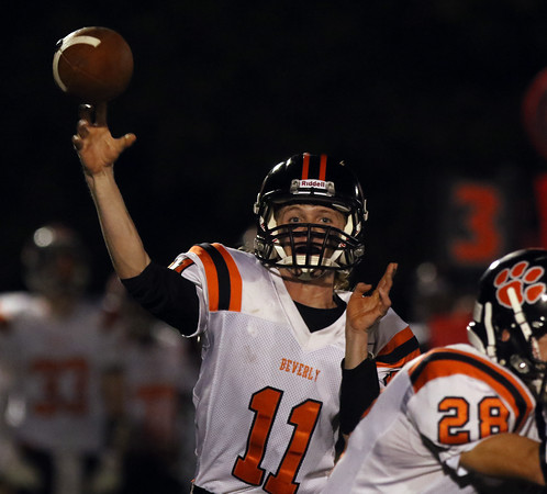 DAVID LE/Staff photo. Beverly quarterback Kevin Morency fires a screen pass to his right against Marblehead. 10/7/16.