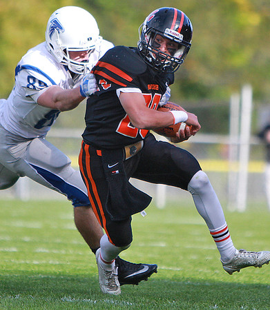 Beverly's Sam Abate carries the ball in a game against the Danvers Falcons Saturday, October 15, at Hurd Stadium. Photo by Nicole Goodhue Boyd