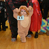 RYAN HUTTON/ Staff photo<br /> Sophia Pena, 1, toddles her way into the Peabody Halloween celebration at the Knights of Columbus hall on Thursday.