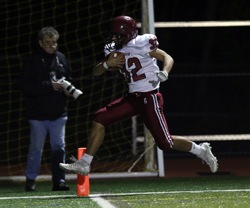 DAVID LE/Staff photo. Gloucester sophomore Marc Smith (32) leaps across the goal line for another Fishermen score on Friday. 10/14/16.
