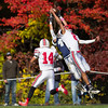 Jared Charney / Photo Amesbury's Zachary Levarity goes high to break up a pass play to Hamilton-Wenham's Cam Peach at Hamilton-Wenham High School, Saturday, October 15, 2016.