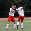 DAVID LE/Staff photo. Beverly junior Dakota Lillelund (11) gets a high five from teammate Ben Sarcione (21) after he scored on a free kick to put the Panthers up 5-0. 9/28/16.