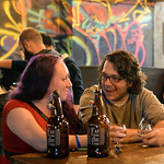 RYAN HUTTON/ Staff photo Katie Hill, of Salem, and John Oellette, of Peabody enjoy some hard cider at Far From The Tree on Jackson Street in Salem on Thursday night.