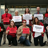 DAVID LE/Staff photo. Members of the Divest SSU group hold signs before they attended a Board of Trustee meeting at Marsh Hall on Thursday afternoon. The Salem State University Board of Trustees voted on Thursday whether to divest from fossil fuel companies and a few supporters from the Divest SSU group spoke at the meeting in favor of the move. 10/13/16.