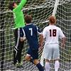 Ipswich goalie Nick Roesler grabs the corner ball to prevent a Hamilton-Wenham goal.<br /> <br /> Photo by JoeBrownPhotos.com
