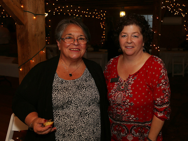 DAVID LE/Staff photo. Jeanne McCormack, left, and Library Trustee Martha Cavanaugh, at the Starry, Starry Night Fundraiser held at the Smith Barn on Brooksby Farm. 10/6/16.