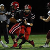 DAVID LE/Staff photo. Salem senior captain Jared Lubas (1) finds running room against Gloucester on Friday evening. 10/14/16.