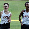 DAVID LE/Staff photo. Beverly freshman Michael Brock, left, and Salem senior Danny Nguyen battle to a close finish. 10/11/16.