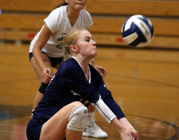 DAVID LE/Staff photo. Hamilton-Wenham junior Cecily Szady winces while recording a dig against Masco. 10/12/16.
