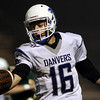 DAVID LE/Staff photo. Danvers senior quarterback Dean Borders reaches the ball across the goal line on a quarterback keeper for the Falcons first score of the game. 9/30/16.