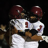 DAVID LE/Staff photo. Gloucester senior captain Christian Sanfilippo (9) celebrates his touchdown run with classmate Eric Cameron (3). 10/14/16.