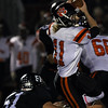 DAVID LE/Staff photo. Beverly quarterback Kevin Morency tries to evade Marblehead's Bo Millett (51) 10/7/16.