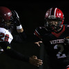 DAVID LE/Staff photo. Salem running back Vinny Gaskins (2) stiff arms Gloucester sophomore Jan Pena-Ortiz (28). 10/14/16.