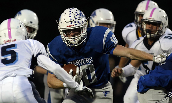 DAVID LE/Staff photo. Danvers senior captain Matt Andreas (10) trains his eyes on Peabody junior Nolan Murphy (5) as he works his way downfield. 10/21/16