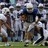 DAVID LE/Staff photo. Danvers quarterback Dean Borders gets dragged down by Peabody senior James McCarthy (88). 10/21/16