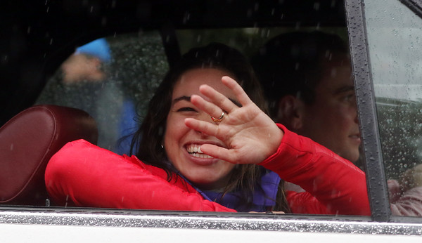 DAVID LE/Staff photo. Topsfield native and Olympian Abbey D'Agostino, smiles and waves to people who braved the rain and lined Main Street  for the Topsfield Fair Parade on Saturday morning, where D'Agostino served as the Grand Marshal. 10/1/16.