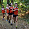 DAVID LE/Staff photo. Beverly senior captain Nora Monahan leads a pack of Beverly runners down a hill during a cross country meet against Salem. 10/11/16.