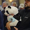 RYAN HUTTON/ Staff photo<br /> Landon Rosa, 5 months, tries to see out of his panda costume while his dad Ricardo holds him at the Peabody Halloween celebration at the Knights of Columbus hall on Thursday.