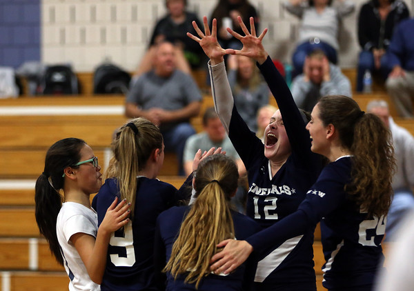 DAVID LE/Staff photo. Hamilton-Wenham junior Lauren Flynn (12) celebrates a block against Masco on Wednesday. 10/12/16.