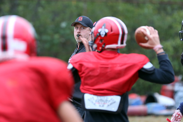 DAVID LE/Staff photo. Salem football head coach Matt Bouchard watches closely as quarterback Jared Lubas drops back to pass during practice. 9/28/16.