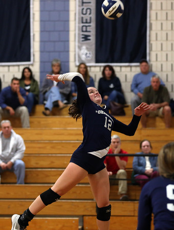 DAVID LE/Staff photo. Hamilton-Wenham junior Lauren Flynn leaps high in the air while smashing a kill over the net against Masco on Wednesday. 10/12/16.