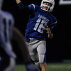 DAVID LE/Staff photo. Danvers senior quarterback Dean Borders (16) fires a first down completion to wide receiver Matt Andreas. 10/21/16