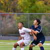 Ipswich Jacob Eliopoulos boxes out Hamilton-Wenham's Nick Ong during the game.<br /> <br /> Photo by JoeBrownPhotos.com