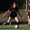 DAVID LE/Staff photo. Beverly senior captain Natalie Mellinger (10) plays the ball upfield against Swampscott. 10/6/16.